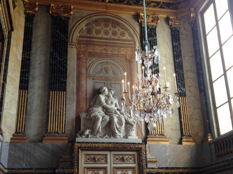 Versailles women embrace